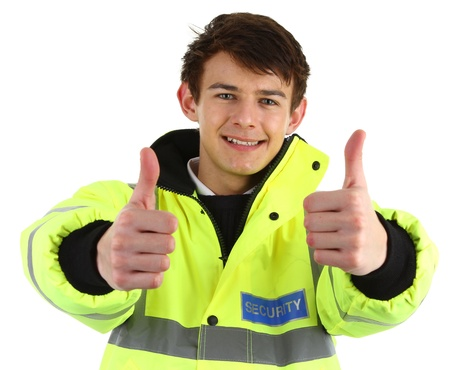 A security guard with a thumbs up sign, isolated on white photo