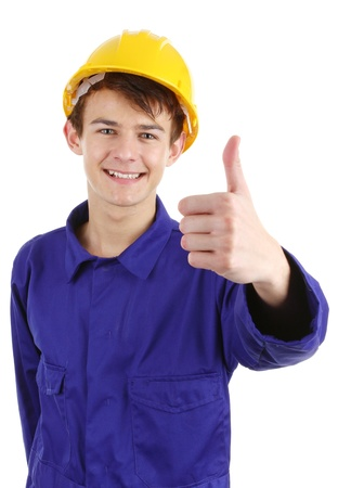 Thumbs up worker with a hard hat, isolated on white photo