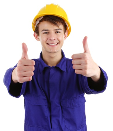 Thumbs up worker, isolated on white photo