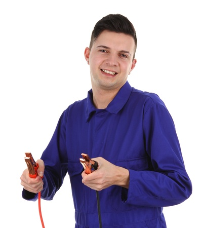 mechanic with battery clamps photo