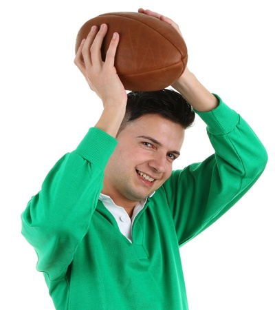 Rugby player holding a ball above his head, isolated on white photo