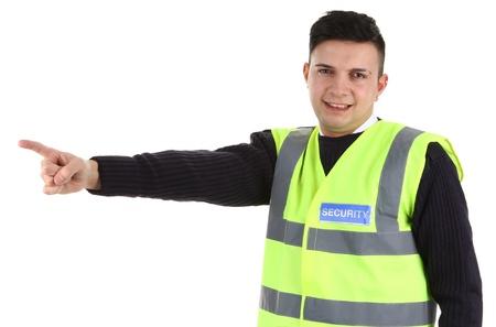 seguridad laboral: Un guardia de seguridad que apunta, aislados en blanco Foto de archivo