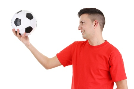 A footballer looking at a football side view on, isolated on white. photo