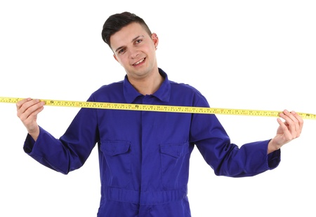 A workman with a tape measure isolated on white photo