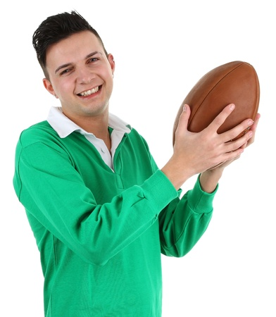 A rugby player in a green shirt holding a rugby ball, isolated on white photo