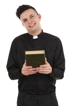 A priest holding a bible, isolated on white photo
