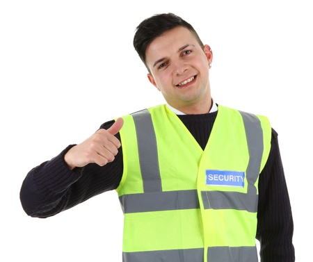 A security guard with a thumbs up sign  Isolated on white photo