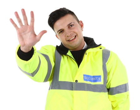 A security guard waving, isolated on white photo