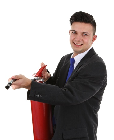 A businessman holding a fire extinguisher, isolated on white photo
