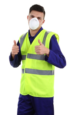 A guy wearing a dust mask with a thumbs up sign photo