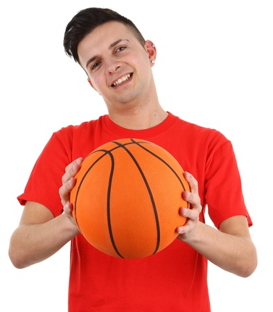 A basketball player holding a ball, isolated on white photo