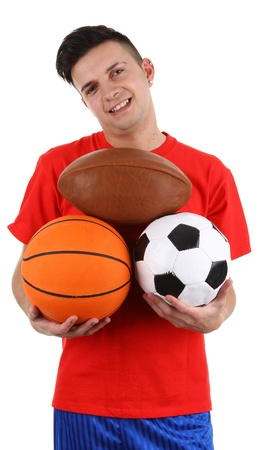 A sports player holding different balls, isolated on white photo