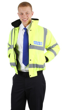 A security guard holding his hands in his pockets, isolated on white Stock Photo - 12790349