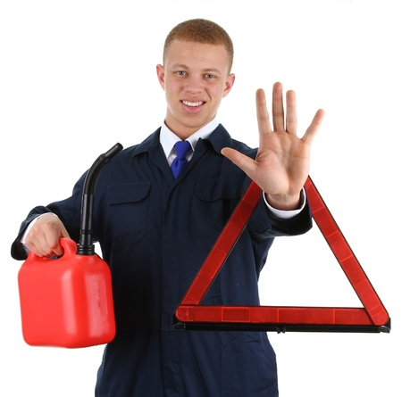 A guy holding a fuel can and a hazard warning triangle photo