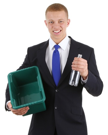 A guy recycling a plastic bottle, isolated on white photo