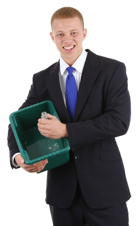 A guy putting a bottle into a recycle bin, isolated on white photo
