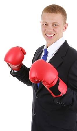 A business guy wearing boxing gloves, isolated on white photo