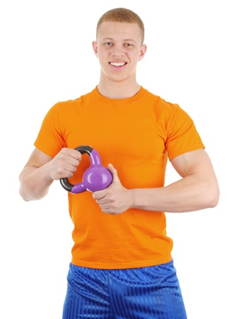 A guy lifting a kettle ball, isolated on white photo