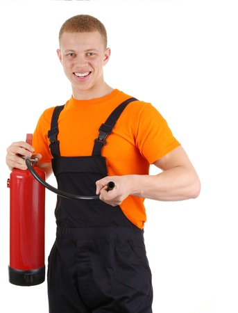 Worker with a fire extinguisher, isolated on white photo