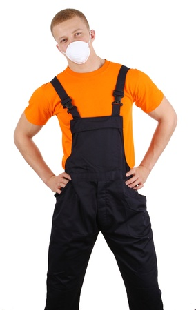Worker with a dust mask, holding his hips, isolated on white photo