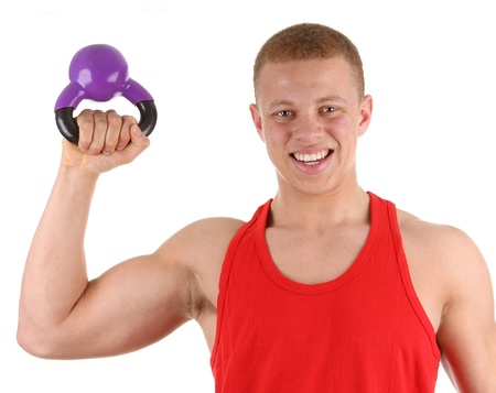 A body builder isolated with a kettle weight photo