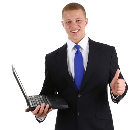 A guy with a laptop and a thumbs up sign, isolated on white photo