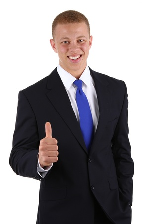 A  businessman with a thumbs up sign, isolated on white photo