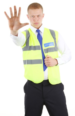 security laws: Security guard with a stop gesture, isolated on white Stock Photo