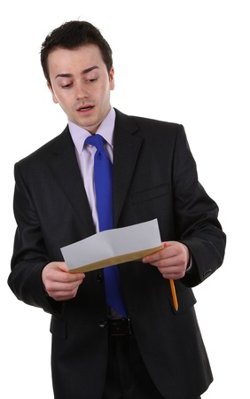 A businessman holding a letter that is shocked, isolated on white photo