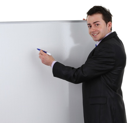 Businessman writing on a white board, isolated on white
