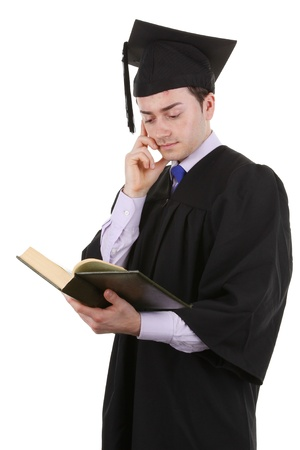 A graduate with a book, isolated on white photo