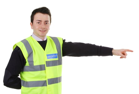 Security guard pointing, isolated on white