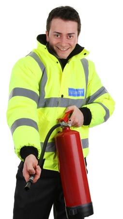 guarda de seguridad: Un guardia de seguridad con un extintor de fuego, aislado en blanco Foto de archivo