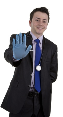 stoppage: A doctor holding out his hand with a stop gesture, isolated on white Stock Photo