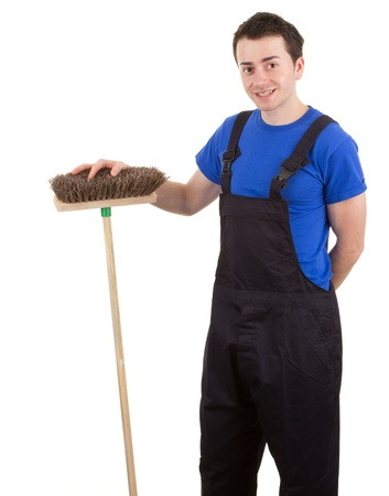 A man with a broom, isolated on white photo