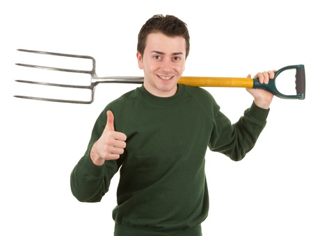A gardener, with a fork, isolated on white photo