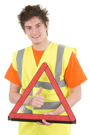 warning vest: A man holding a hazard warning triangle with a thumbs up sign, isolated on white Stock Photo