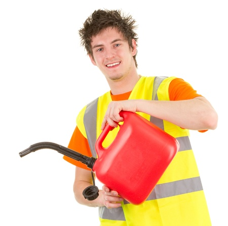 A mechanic pouring from a fuel can, isolated on white Stock Photo