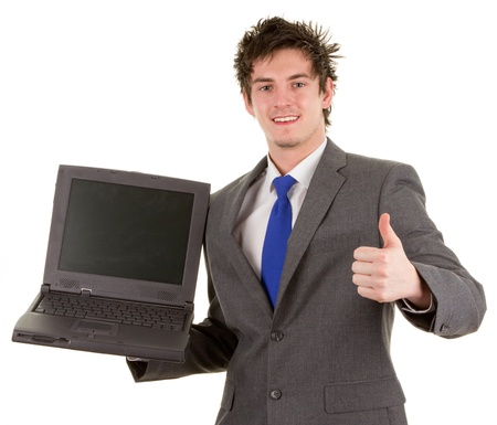 A business worker holding a laptop, showing a thumbs up sign, isolated on white photo