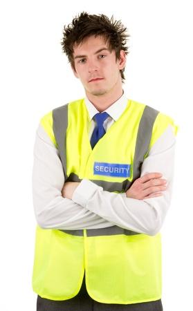 guardia de seguridad: Un grave guardia de seguridad mirando con los brazos cruzados, aislado en blanco