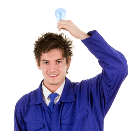 A workman holding a lightbulb above his head, isolated on white photo