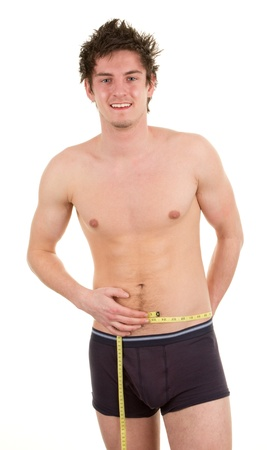 A man holding a tape measure around his waist, isolated on white  Stock Photo