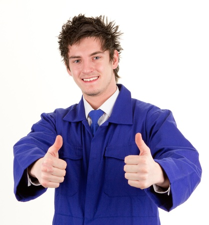 A tradesman with a thumbs up sign, isolated on white photo