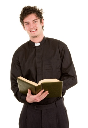 A priest holding a open bible, isolated on white Stock Photo - 14463074
