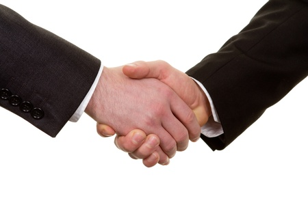 A close up of a handshake taken at an angle just off of face on, isolated on white