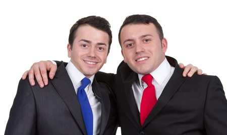 Two men standing close together dressed in business suits, isolated on white