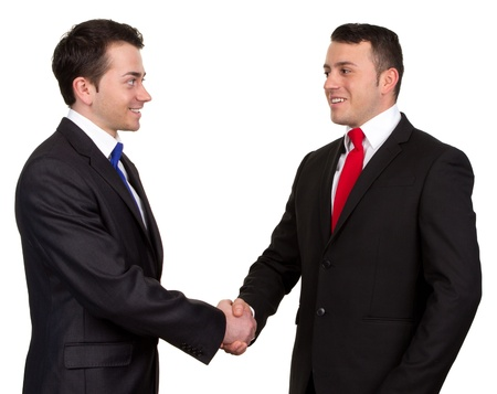 Two businessman shaking hands, isolated on white photo