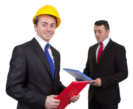 Two construction managers holding files, isolated on white photo