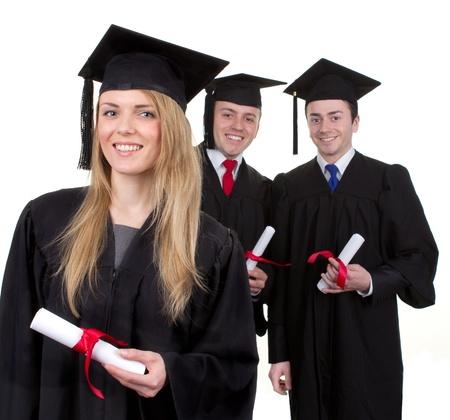 graduacion de universidad: Tres grauates felices con sus rollos