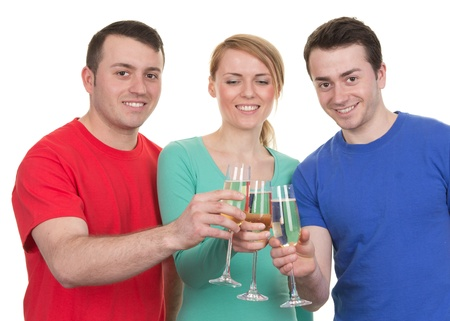 Three friends celebrating with champagne, isolated on white photo